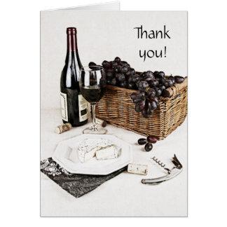 la botella, la copa de vino y el queso de vino le tarjeta pequeña