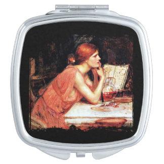 La bruja Circe con el libro de la poción Espejos Maquillaje