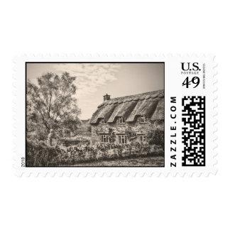 La cabaña cubierta con paja (sellos del vintage B&