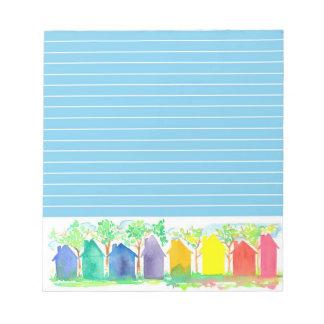 La cabaña del arco iris contiene el azul de la libretas para notas