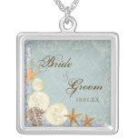 La cabaña floral por el mar descasca el boda con p joyeria personalizada