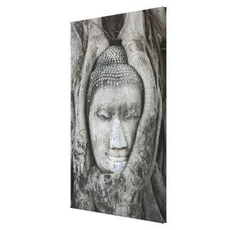La cabeza de la piedra arenisca de Buda rodeó por Lienzo Envuelto Para Galerías