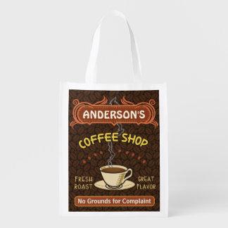La cafetería con la taza crea sus los propios bolsa reutilizable