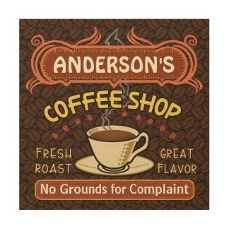 La cafetería con la taza crea sus los propios impresiones en madera
