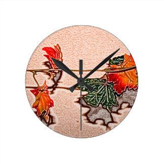 la caída deja el naranja de la hoja del otoño de reloj