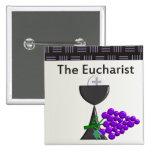La cáliz de la eucaristía y el diseño de las uvas pins