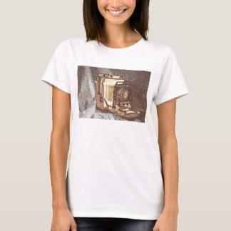 La camiseta de las mujeres de la cámara de la