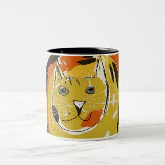 La cara del gato amarillo grande taza de dos tonos