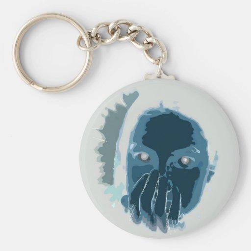 La cara invertida azul con entrega la boca llavero personalizado