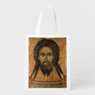 La cara santa (el panel) bolsas para la compra