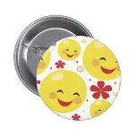 La cara sonriente florece el botón pin