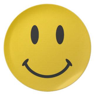 La cara sonriente original platos