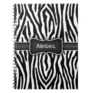 La cebra blanco y negro raya el cuaderno