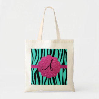 La cebra de la turquesa raya el monograma bolsas