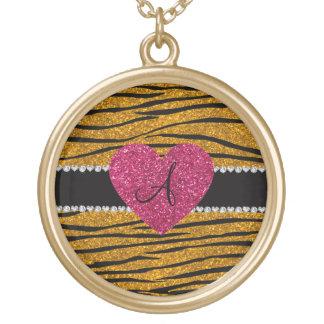 La cebra del brillo del oro del monograma raya el  grimpolas