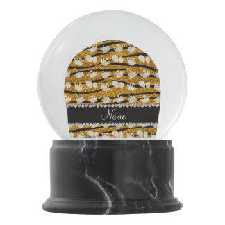 La cebra del brillo del oro raya el globo de la bola de nieve