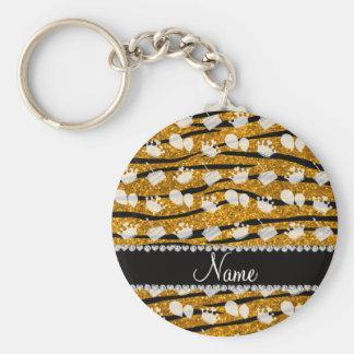 La cebra del brillo del oro raya el globo de la llavero redondo tipo pin