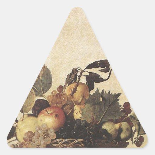 La cesta de Caravaggio de fruta Pegatina Triangular
