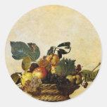 La cesta de Caravaggio de fruta Pegatina Redonda
