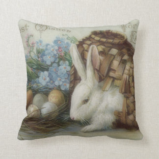 La cesta pintada coloreada del huevo del conejito  cojines