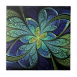 """La Chanteuse IV Abstract Stained Glass Pattern Tile<br><div class=""""desc"""">Ceramic tile with &quot;La Chanteuse IV, &quot; an abstract Apophysis fractal by Susan Wallace. Faux stained glass leaves of green and turquoise frame a central flower in shades of blue and purple.</div>"""