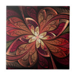 """La Chanteuse Rouge Ceramic Tile<br><div class=""""desc"""">Copyright &#169; 2014,  Susan Wallace. Faux stained glass leaves in shades of red,  orange and gold frame a central flower of bright yellow in this intricate abstract piece.</div>"""