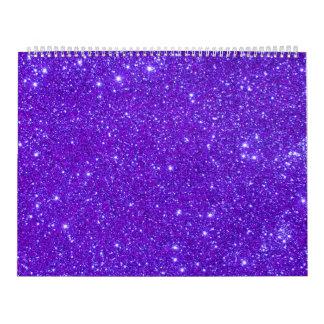 La chispa púrpura del brillo crea el calendario pa