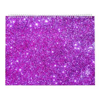 La chispa púrpura rosada del brillo crea el calend calendarios