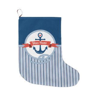 La cinta náutica de la cuerda del ancla raya el bota navideña grande