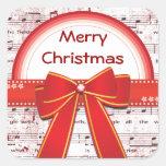 La cinta roja de las Felices Navidad observa al Colcomania Cuadrada