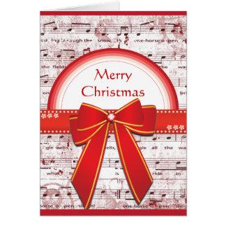 La cinta roja de las Felices Navidad observa la ta Tarjeta De Felicitación