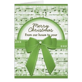La cinta verde de las Felices Navidad observa la Tarjeta De Felicitación