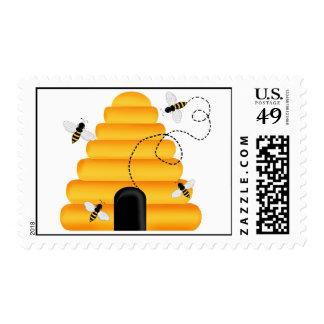 La colmena manosea sellos de la abeja