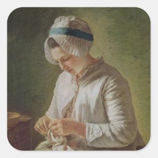 La costurera o, funcionamiento de la mujer joven pegatina cuadrada