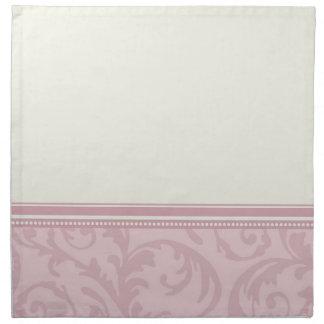 La crema rosada remolina las servilletas de cena e