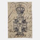 la cruz y la corona del vintage diseñan en backgro toalla de cocina