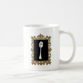 La cuchara enmarcada taza de café