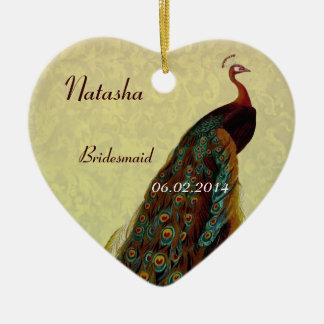 La dama de honor del oro le agradece pavo real del ornamento de navidad