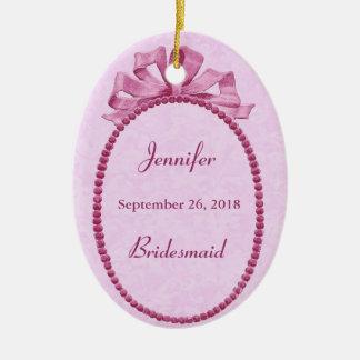 La dama de honor rosada del arco del vintage le adorno navideño ovalado de cerámica