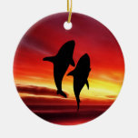 La danza de las ballenas en la puesta del sol adorno para reyes