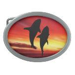 La danza de las ballenas en la puesta del sol hebillas de cinturón