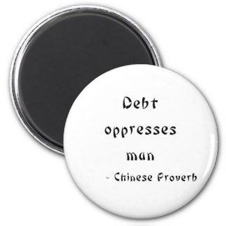 La deuda oprime al hombre imán redondo 5 cm