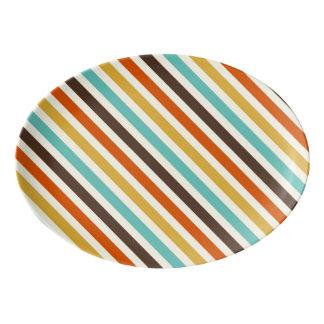 La diagonal raya rojo amarillo azul de 4 colores badeja de porcelana
