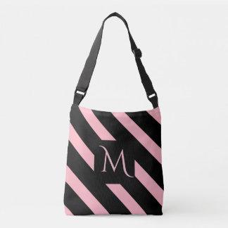 La diagonal rosada y negra ancha raya el monograma bolsa cruzada