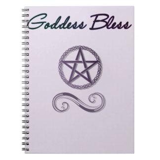 La diosa bendice el cuaderno