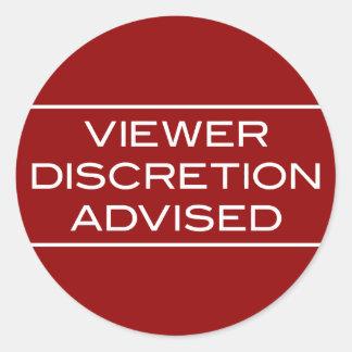La discreción del espectador aconsejó alrededor etiquetas redondas