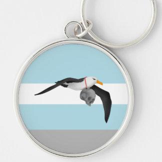 La escarcha del cráneo antiguo del albatros del llavero redondo plateado