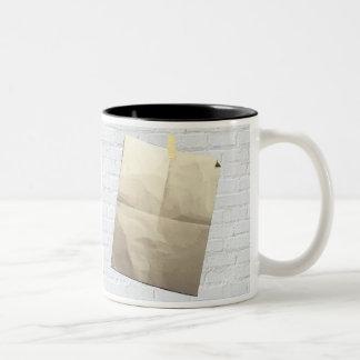 La escritura en la taza de la pared