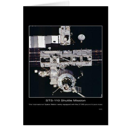 La estación espacial internacional con el braguero tarjeta de felicitación