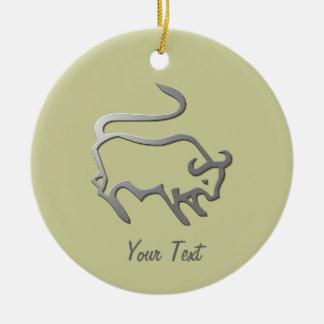 La estrella del zodiaco del tauro firma adentro la adorno navideño redondo de cerámica